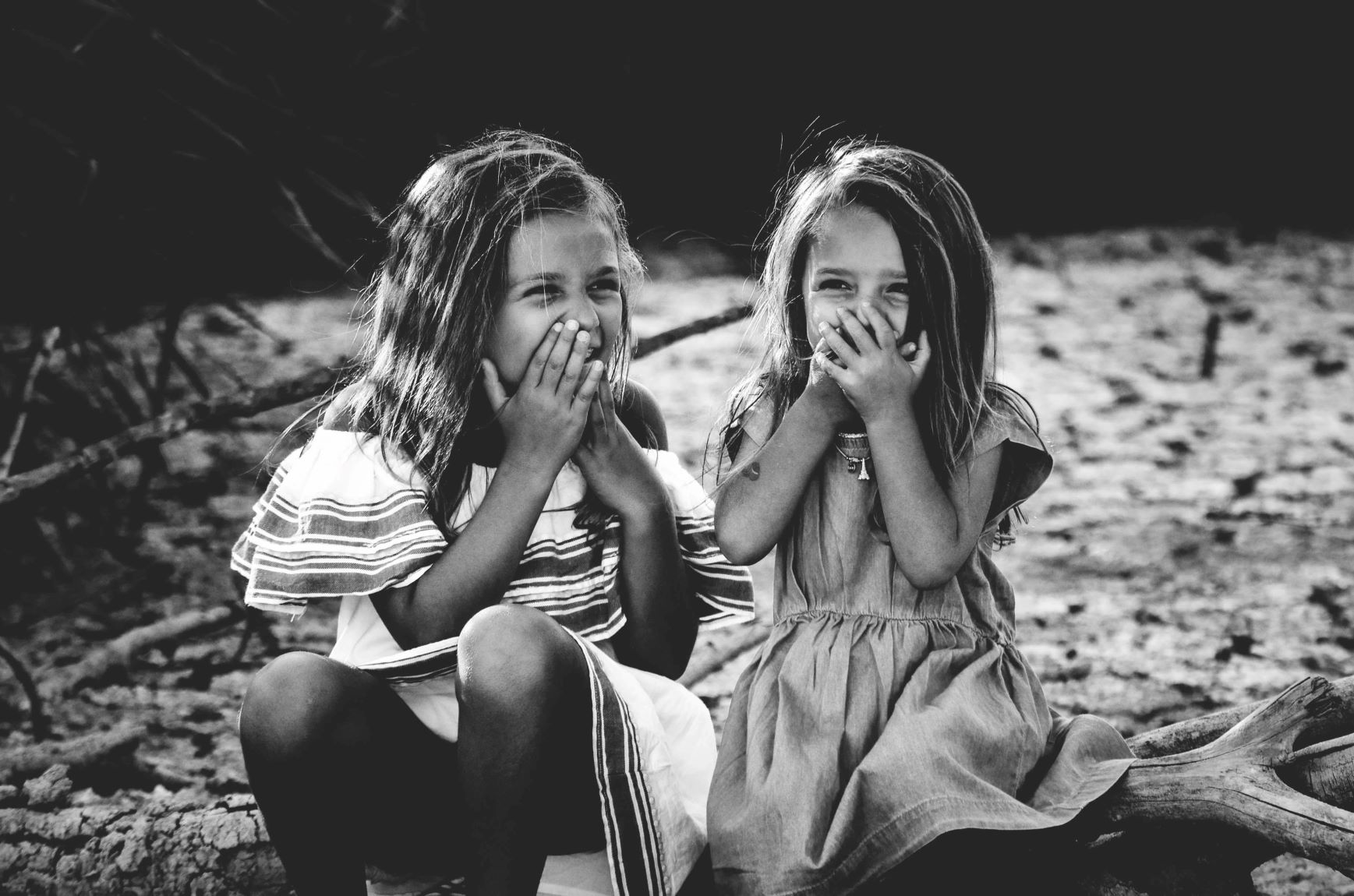 two littel girls giggling bw photo
