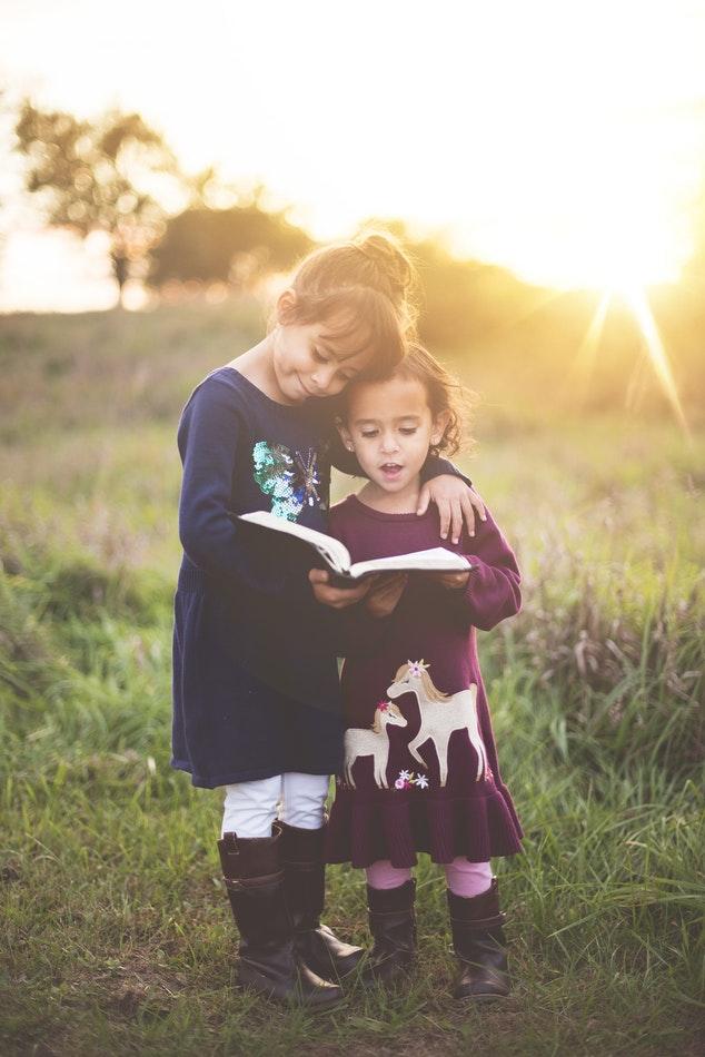 little girls reading
