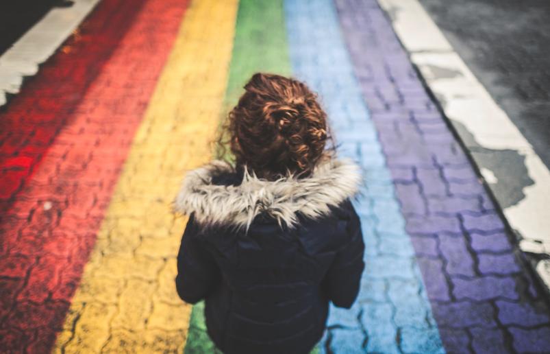 child with rainbow sidewalk